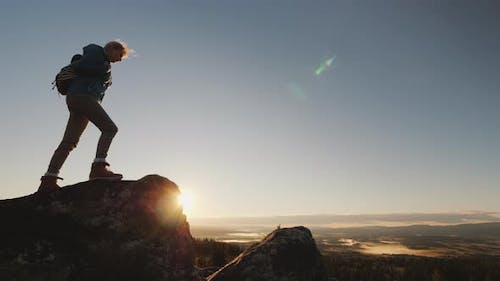Active Woman Reaches the Top of the Mountain, Admires the Magnificent Scenery of Norway