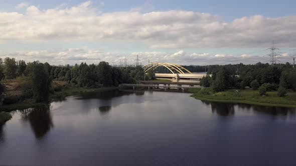 Thumbnail for Flying Over Beautiful Landscape a Large Automobile Bridge Over the Lake, Forest.
