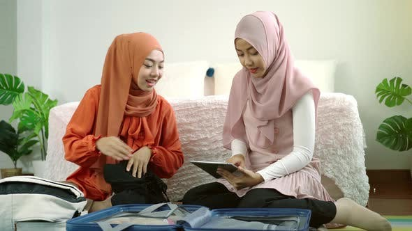 Thumbnail for Asian Muslim Women Packing Suitcase 01