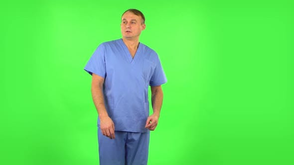Thumbnail for Medical Man Is Frightened, Then Sighs in Relief and Waves a Smile at Someone. Green Screen