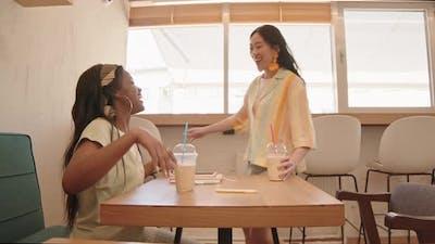 Girlfriends Meeting in Cafe