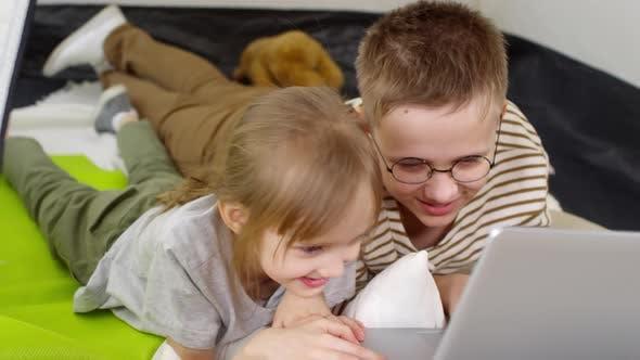 Thumbnail for Children Using Laptop