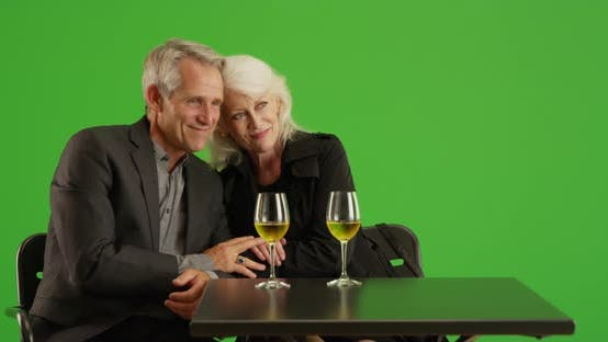 Thumbnail for Elderly couple out on a date and having a good time on green screen