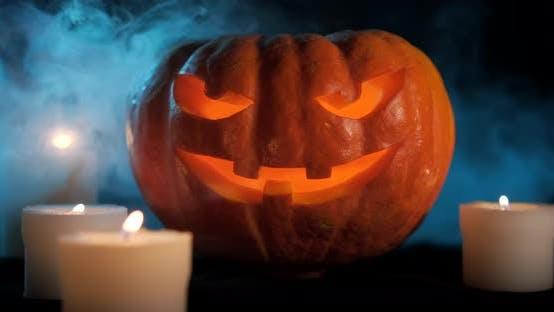 Thumbnail for Halloween Pumpkin On Dark Smoky Background