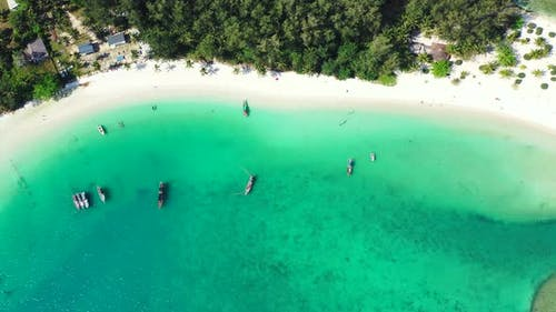 Beautiful drone tourism shot of a sunshine white sandy paradise beach and blue water background in c
