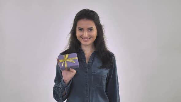 Thumbnail for Caucasian Female Holding Gift