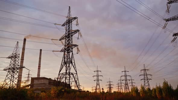 Thumbnail for High-voltage electric towers at sunset
