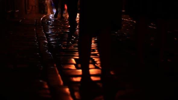 Dark Street and People Walking By