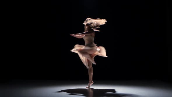 Young Woman Dancer Dancing Contemporary Dance and Doing a Split, on Black, Shadow