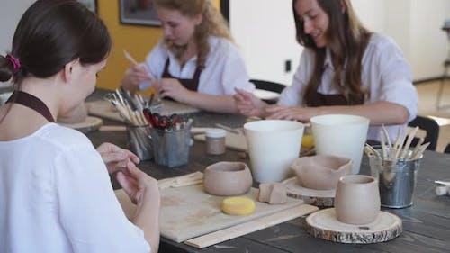 Beautiful Young Female Artist Girls Creating Handmade Pottery in Modern Art Studio. Education Kids
