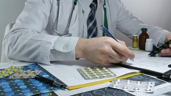 Thumbnail for Doctor Fills The Prescription For Pills In The Hospital