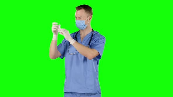 Thumbnail for Male Doctor Preparing a Syringe for Injection. Green Screen