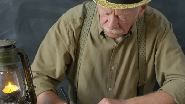 Thumbnail for Portrait of Old-Fashioned Elderly Man Writing Poem