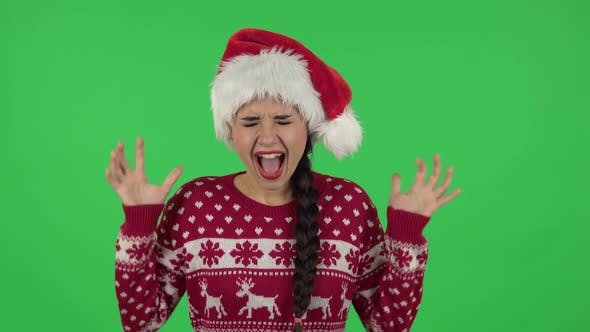 Thumbnail for Portrait of Sweety Girl in Santa Claus Hat Is Screaming. Green Screen