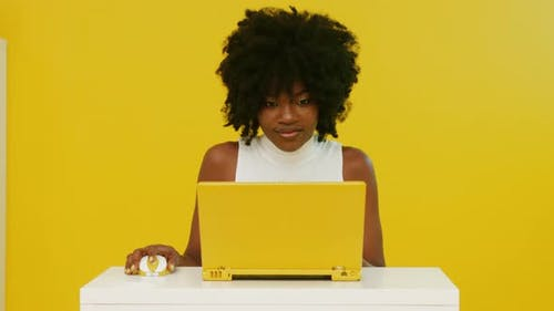 Stylish Black Woman Uses Yellow Laptop