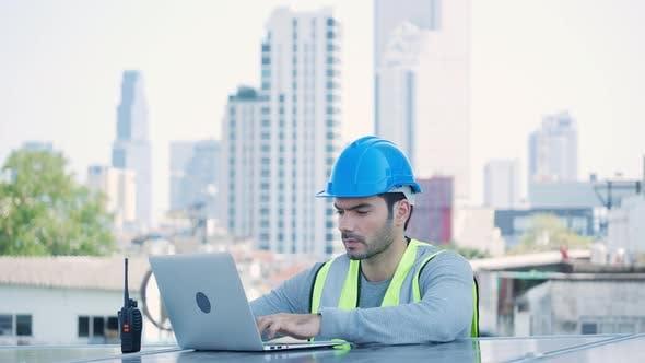 Ecological engineer using laptop