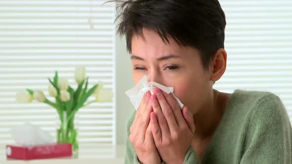 Thumbnail for Woman sick with flu sneezing