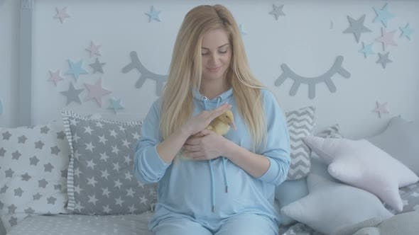 Thumbnail for Charming Happy Woman Stroking Yellow Duckling. Portrait of Positive Pregnant Caucasian Lady Playing