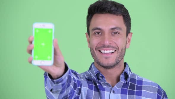 Face of Happy Young Hispanic Man Showing Phone
