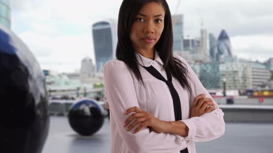 Thumbnail for Black businesswoman near City Hall of London looking at camera confidently
