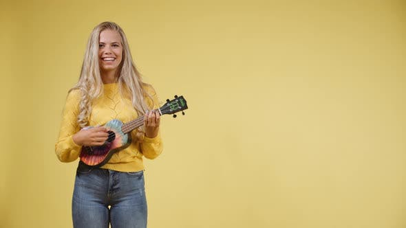 Thumbnail for Talented Blonde Woman Singing while Playing the Ukulele