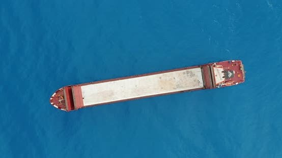 Aerial View, Red Deck Cargo Ship Sailing on Open Sea