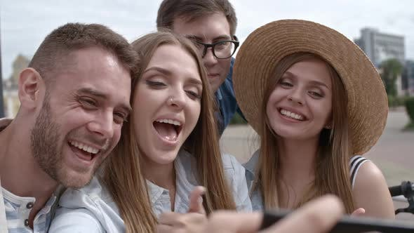 Thumbnail for Company of Friends Smiling at Camera While Taking Selfie