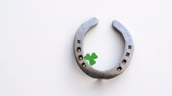 Horseshoe with Shamrock on White Background