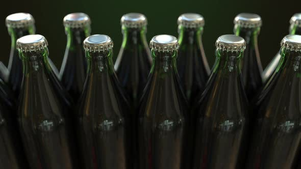 Cover Image for Line of Closed Green Bottles with Beer or Water