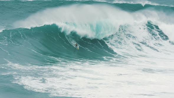 Surfer in Caught Giant Wave in Atlantic Ocean, Instructor Accompanies Nearby on Jet Ski