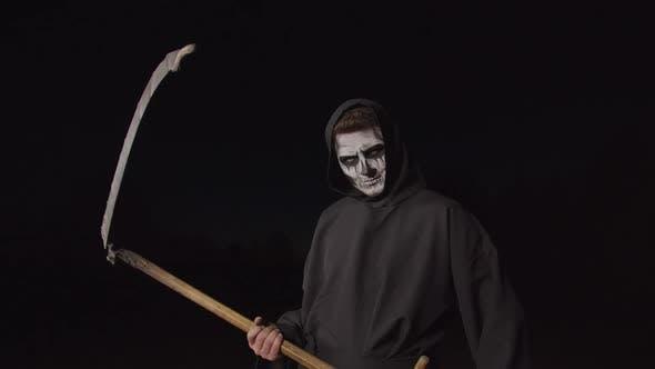 Thumbnail for Scary Death Holding Scythe on Halloween Night