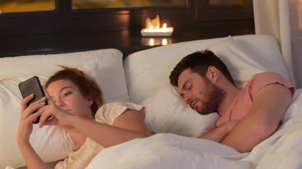 Thumbnail for Woman Using Smartphone While Boyfriend Is Sleeping 31