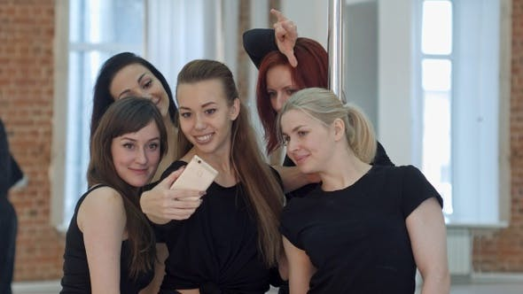 Thumbnail for Group of Young Women Taking a Selfie During a Break On