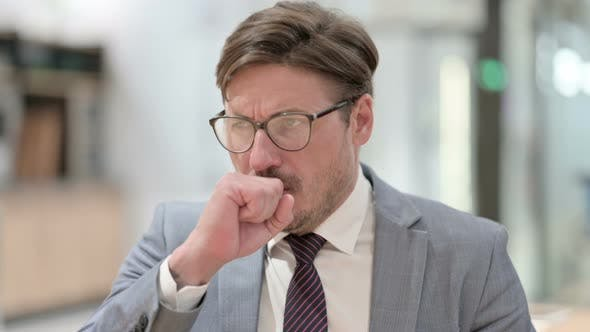 Coughing Sick Businessman