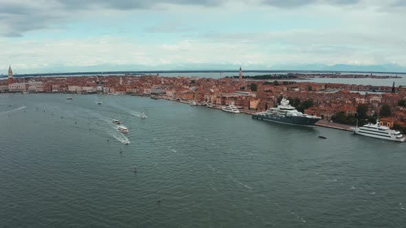 Venice Lagoon Aerial View with Luxury Yachts Docked Near Venice Center