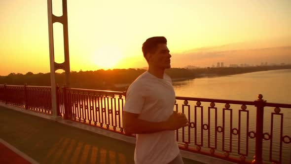 Thumbnail for Athletic Man Jogging During Sundown