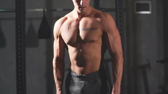 Thumbnail for Male Athlete with Naked Torso, Highly Defined Muscles
