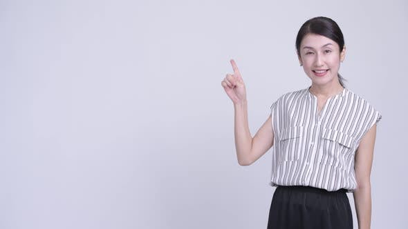 Thumbnail for Happy Beautiful Asian Businesswoman Thinking and Pointing Up