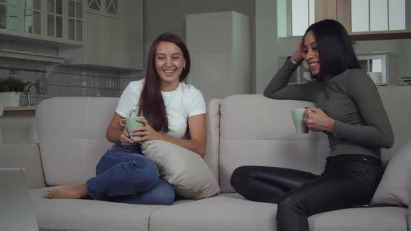 Thumbnail for Beautiful young girls girls talking on sofa