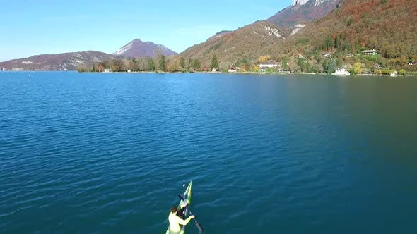 Thumbnail for A kayaker paddles in a scenic mountain lake.