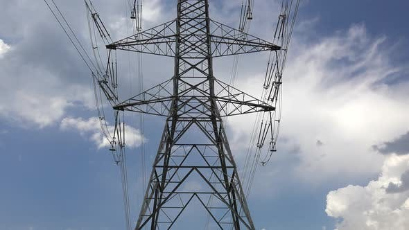 Looking at the Transmission Overhead Power Tower Line Towards the Sky