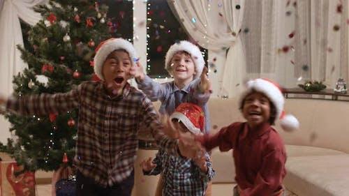 Darkskinned Children Using Christmas Petard.