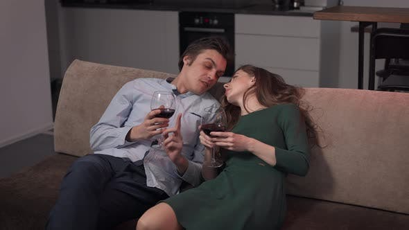 A Couple of Lovers at Home Drinking Wine