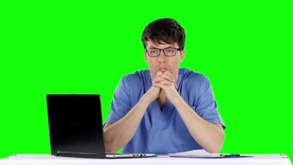 Cover Image for Young Worried Doctor Holding His Head. Green Screen
