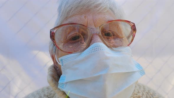 Thumbnail for Portrait of Granny Wearing Protective Mask From Virus. Elderly Lady Looking Into Camera Showing Sad