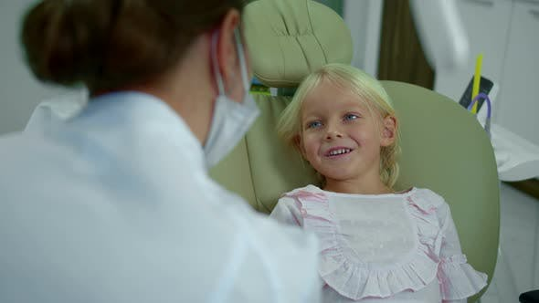 Thumbnail for Girl Stopes Smiling While Talking To the Dentist.