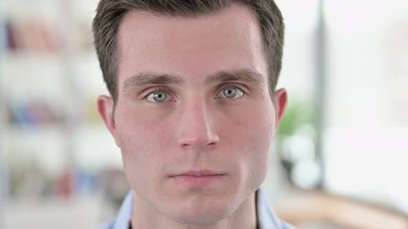 Thumbnail for Close Up of Serious Young Man Face