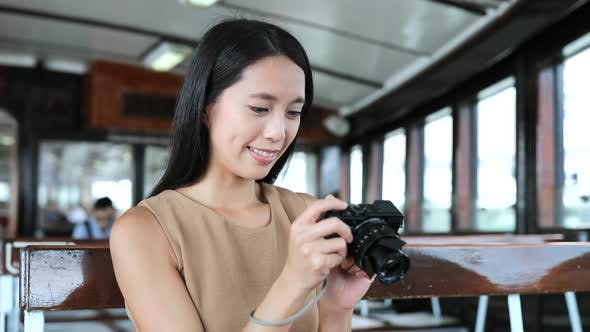 Thumbnail for Woman taking photo with digital camera on ferry