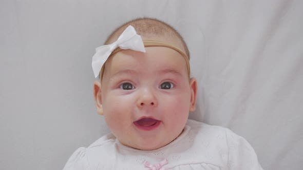 Thumbnail for Portrait of Sweet Little Baby Girl Smiles. Closeup.