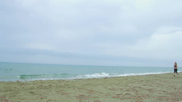 Thumbnail for Strong Slim Woman Running Alone at Seaside. Diet and Sport for Healthy Life